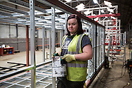 'Untitled, 2014' from the project 'The Fall and Rise of Ravenscraig' by photographer Colin McPherson.<br /> <br /> Image shows Kaylee Darragh, pictured at work at Enemetric, a Wishaw-based company which makes complete housing units on site at their factory. Kaylee retrained at New College Lanarkshire after years of working for McDonalds.<br /> <br /> This project, photographed in 2014, looks at the topography of the post-industrial landscape at Ravenscraig, the site until its closure in 1992 of the largest hot strip steel mill in western Europe. In its current state, Ravenscraig is one of the largest derelict sites in Europe measuring over 1,125 acres (4.55 km2) in size, an area equivalent to 700 football pitches or twice the size of Monaco. It is currently being developed with a mix of housing, retail and the home of South Lanarkshire College and the Ravenscraig Regional Sports Facility.