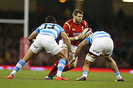Dan Biggar of Wales breaks past Matias Orlando (l) and Javier Ortega of Argentina. Under Armour 2016 series international rugby, Wales v Argentina at the Principality Stadium in Cardiff , South Wales on Saturday 12th November 2016. pic by Andrew Orchard, Andrew Orchard sports photography