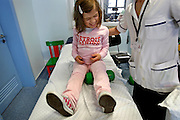 PMM020409#_Marta, daughter of Laurinda and the normal heigh father, both with achondroplasia dwarfism inside the Estefania's Hospital. Marta has being doing a bone structure enlargment treatment during the last 4 years, her height increased more 30cm then the expected for her natural condition. In 4 years, she will complete the treatment until she reach the height of 1,5 m.