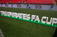 The Emirates FA Cup signage on the pitch ahead of the FA Cup semi-final match between Watford and Wolverhampton Wanderers at Wembley Stadium in London, England on 7 April 2019.