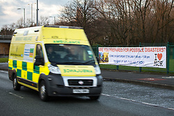 """© Licensed to London News Pictures . 19/01/2018 . Manchester , UK . An ambulance is driven past a banner hung from railings in front of The Church of Jesus Christ of Latter-day Saints on the A560 Altrincham Road in Wythenshawe which references Salman Abedi's murderous terror attack on the Manchester Arena with the use of a photograph from the scene of the attack , alongside the words """" Are you prepared for possible disaster """" and the logo of the I Love Mcr charity . The banner features an invitation to visit the church """" To see if we can help"""" . Photo credit : Joel Goodman/LNP"""