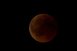 "The moon during the total lunar eclipse seen in the sky above Reggio Calabria in southern Italy on July 27, 2018. The longest ""blood moon"" eclipse this century began on July 27, coinciding with Mars' closest approach in 15 years to treat skygazers across the globe to a thrilling celestial spectacle. 27 Jul 2018 Pictured: The moon during the total lunar eclipse seen in the sky above Reggio Calabria in southern Italy on July 27, 2018. Photo credit: Stefano Costantino / MEGA TheMegaAgency.com +1 888 505 6342"