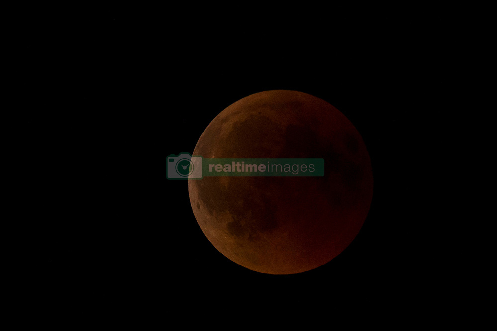 """The moon during the total lunar eclipse seen in the sky above Reggio Calabria in southern Italy on July 27, 2018. The longest """"blood moon"""" eclipse this century began on July 27, coinciding with Mars' closest approach in 15 years to treat skygazers across the globe to a thrilling celestial spectacle. 27 Jul 2018 Pictured: The moon during the total lunar eclipse seen in the sky above Reggio Calabria in southern Italy on July 27, 2018. Photo credit: Stefano Costantino / MEGA TheMegaAgency.com +1 888 505 6342"""