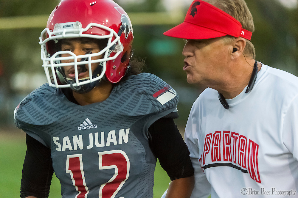 San Juan Spartans head coach Greg Roeszler talks to his player Tongo Lomano (12), during the first quarter as the San Juan Spartans host the Mira Loma Matadors, Friday Sep 16, 2016.<br /> photo by Brian Baer