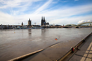 flood of the Rhine on February 4th. 2021, view from the flooded bank of the Rhine in Deutz to the Cathedral and the church Gross St. Martin, Cologne, Germany.<br /> <br /> Hochwasser des Rheins am 4. Februar 2021, Blick vom ueberfluteten Rheinufer in Deutz zum  Dom und der Kirche Gross St. Martin, Koeln, Deutschland.