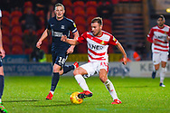 Herbie Kane of Doncaster Rovers (15) cuts back towards Sam Mantom of Southend United (18) during the EFL Sky Bet League 1 match between Doncaster Rovers and Southend United at the Keepmoat Stadium, Doncaster, England on 12 February 2019.