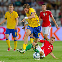 Sweden's Johan Elmander (L) fights for the ball with Hungary's Vladimir Koman (R) during the UEFA EURO 2012 Group E qualifier Hungary playing against Sweden in Budapest, Hungary on September 02, 2011. ATTILA VOLGYI