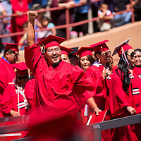 051513       Brian Leddy<br /> University of New Mexico-Gallup graduate Casey Charley celebrates after receiving his degree at Red Rock Park Wednesday. Charley earned an associate degree in Collision Repair Technology.