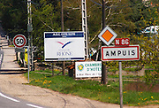 The entrance to Ampuis with road signs with the name of the town and a big sign saying that this is Cote Rotie, in the Cotes du Rhone. Ampuis, Cote Rotie, Rhone, France, Europe