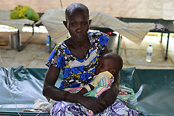 June 28, 2017 - Juba, Jubek, South Sudan - Christine Abel, 2, who suffers from malnourishment and a severe case of cholera, is held in the arms of her Grandmother Maria Apoco Wednesday in the General Hospital In Juba, South Sudan, where more than half the population is suffering from a severe humanitarian crisis including near-famine.  Baby Christine lost her parents during a fighting between Government forces and rebel factions in the town of Gumbo in April.  They live in the Don Bosco refugee camp. (Credit Image: © Miguel Juarez Lugo via ZUMA Wire)