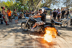 Shooting flames from the exhaust at the Garage Build Bike Show at the Broken Spoke Saloon in Ormond Beach during Daytona Beach Bike Week, FL. USA. Friday, March 15, 2019. Photography ©2019 Michael Lichter.