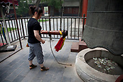 "Ringing the large bell, an honour you can pay to do at Yonghe Temple, also known as the ""Palace of Peace and Harmony Lama Temple"", the ""Yonghe Lamasery"", or - popularly - the ""Lama Temple"" is a temple and monastery of the Geluk School of Tibetan Buddhism located in the northeastern part of Beijing, China. It is one of the largest and most important Tibetan Buddhist monasteries in the world. The building and the artworks of the temple is a combination of Han Chinese and Tibetan styles."