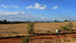 © Licensed to London News Pictures. Iten, Kenya. Double world and Olympic champion MO FARAH poses for a photograph during training at an altitude training camp based at 2,500m in Iten, Kenya, ahead of the 2014 Virgin Money London Marathon in April this year. The Somalia born, adopted Brit, is looking to make the jump from the 10,000m distance to a full marathon for the first time in front of a home crowd. Photo credit : Mike King/LNP
