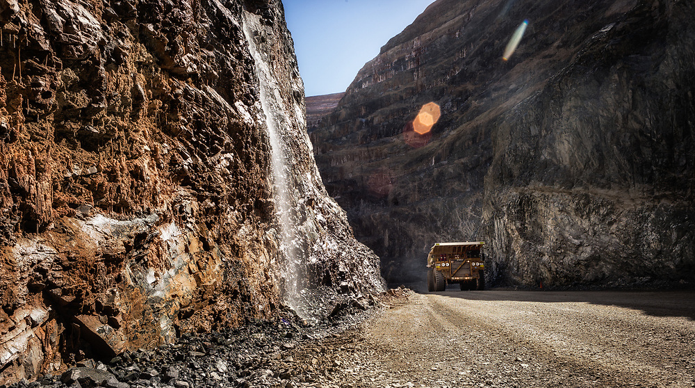 An ore haulage truck moves ore from an open pit in the Pilbara region of Western Australia.