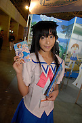 An exhibition promotion girl holding a flier for console software.