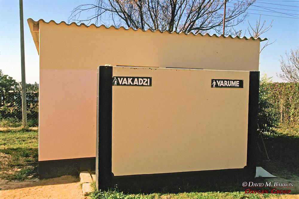 Men & Women's Bathrooms Sign In Local Language