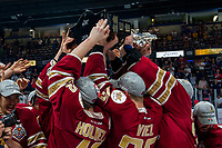 REGINA, SK - MAY 27:  Olivier Galipeau #26, Jeffrey Truchon-Viel #25 and Adam Holwell #13 of Acadie-Bathurst Titan hoist the Memorial Cup trophy at centre ice after the win against the Regina Pats at Brandt Centre - Evraz Place on May 27, 2018 in Regina, Canada. (Photo by Marissa Baecker/CHL Images)
