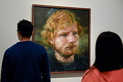 © Licensed to London News Pictures. 03/05/2017. London, UK.  Visitors to the National Portrait Gallery view a newly acquired portrait of the popular singer-songwriter Ed Sheeran, by artist Colin Davidson.  The 4ft x 4ft painting oil painting is the first portrait painted of the singer since the start of his professional career and has just been put on public display.   Photo credit : Stephen Chung/LNP
