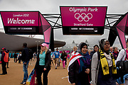 London 2012 Olympic Park in Stratford, East London. Crowds of fans walking into the site at the Straford Gate entrance / exit.