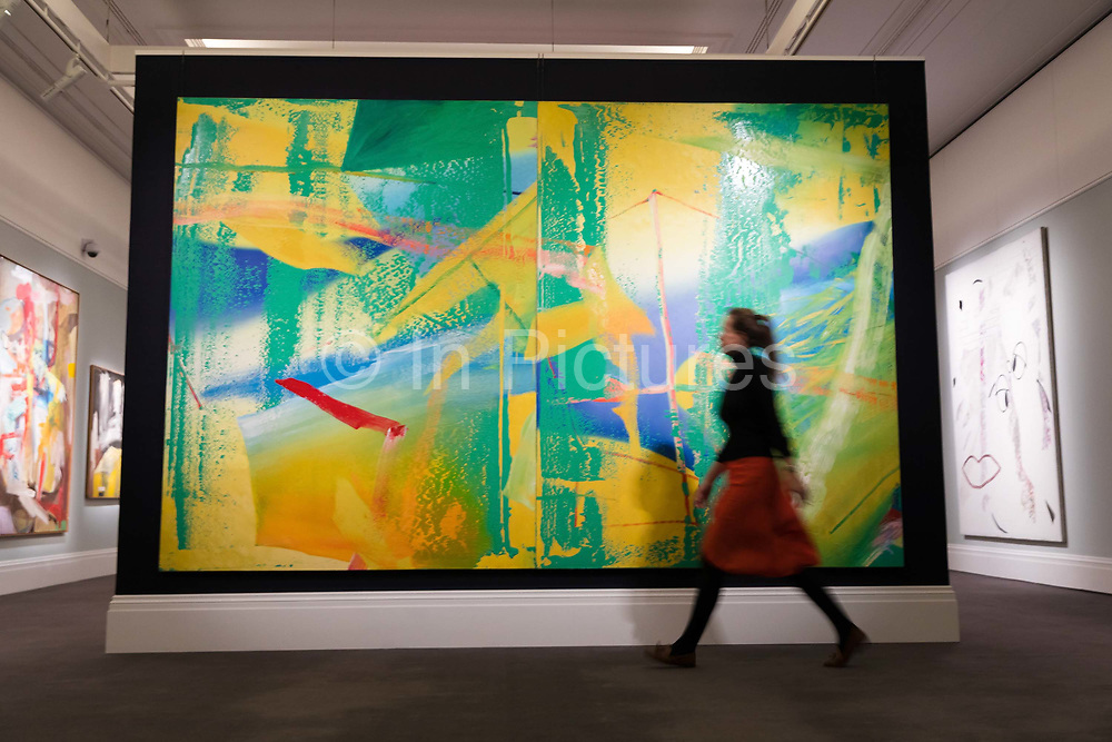 A member of staff walks pass Gelbrun 1982 by Gerhard Richter  on February 22nd, 2018 at the preview for Sothebys upcoming Impressionist, Modern and Surrealist Art auction at Sothebys in New Bond Street, London, England.