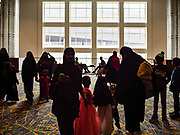 04 JUNE 2019 - DES MOINES, IOWA: People walk into the community Eid al Fitr services in the Iowa Events Center in Des Moines Tuesday. About 3,000 people were expected to attend the annual community wide celebration of Eid al Fitr which marks the end of Ramadan, the Muslim month of fasting. According to the event organizers, there are about 15,000 Muslims in the Des Moines area.           PHOTO BY JACK KURTZ