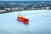 Cargo carrier navigates the famous crescent shaped riverbend on the Lower Mississippi River toward its destination at the Port of New Orleans.