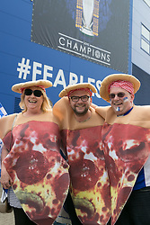 © Licensed to London News Pictures. 07/05/2016. Leicester, UK. Leicester City fans celebrating outside the King Power stadium before their match with Everton before lifting the Premiership trophy. Pictured, Pizza, Pizza everywhere. Photo credit: Dave Warren/LNP