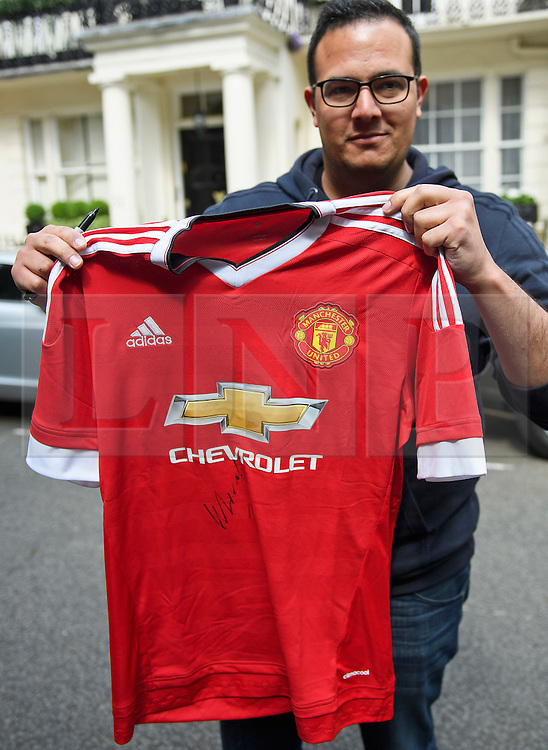 © Licensed to London News Pictures. 27/05/2016. London, UK.  STEVEN RIBEIRO from Portugal, holds up his Manchester United FC shirt which was signed by Jose Mourinho as he  left his home in west London on the day he was officially announced as the new manager of Manchester United Football Club. Photo credit: Ben Cawthra/LNP