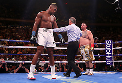 Anthony Joshua (left) appears dejected against Andy Ruiz Jr (right) in the WBA, IBF, WBO and IBO Heavyweight World Championships title fight at Madison Square Garden, New York.