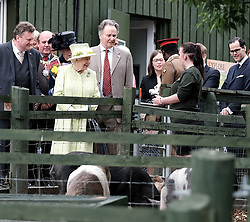 The Queen visited Gorgie City Farm in Edinburgh today as part of Royal Week.<br /> <br /> Gorgie City Farm is a community based initiative first opened in 1982<br /> <br /> Pictured: The Queen is shown around the inner city farm meeting staff and volunteers <br /> <br /> Alex Todd | Edinburgh Elite media