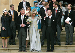 File photo dated 09/04/05 of the Prince of Wales and the Duchess of Cornwall with the Duke of Edinburgh (right) and other members of the Royal Family as they leave St George's Chapel in Windsor, following the church blessing of their civil wedding ceremony. Charles and Camilla are celebrating their 15th wedding anniversary on Friday, after they were reunited on Monday when the 72-year-old duchess came out of a 14-day self-isolation on the Balmoral estate in Aberdeenshire.