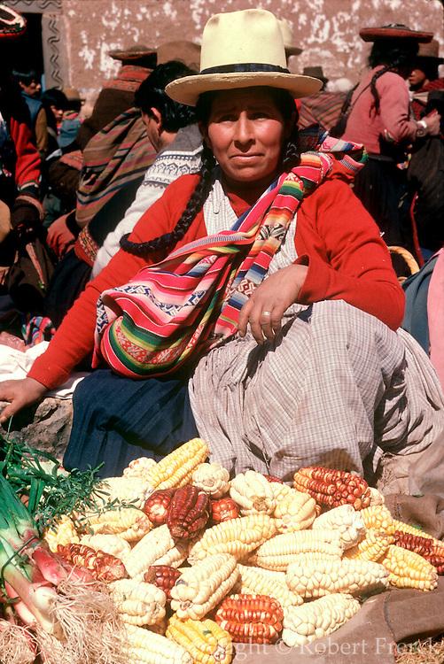 PERU, HIGHLAND, MARKETS Chincheros, selling types of corn