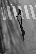 Paris. elevated view on pedestrians crossing a street in winter light / pietons traversant une rue , vu d'en haut