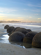Looking north over the famous Moeraki Boulders (Kaihinaki), Moeraki Beach,  New Zealand.