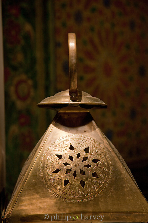 A brass metal lantern for sale at a shop in the medina in Fes, Morocco