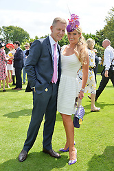 JEREMY KYLE and his wife CARLA at the 2014 Glorious Goodwood Racing Festival at Goodwood racecourse, West Sussex on 31st July 2014.