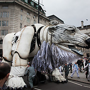 The giant polar bear puppet Aurora made by Greenpeace walked the streets of London in defence of the Arctic as part of a Greenpeace global day of action. The parade,part performance part protest, was to highlight the melting ice caps and the increasing and potentially devastating oil drilling in the arctic sea. Shell is one of the companies drilling and the march through London ended up outside Shell London HQ to draw attention to their oil business in the arctic. Aurora, the biggest polar bear in the world represents all endangered species in arctic.