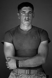 Lcpl. Dustin Schaffner, 22, Midland, Texas. Machine-gunner. Weapons Platoon, Kilo Company, 3rd Battalion, 1st Marine Regiment, 1st Marine Division, United States Marine Corps, at the company's firm base in Hit, Iraq on Friday Sept. 23, 2005.