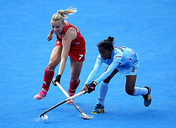 England's Hannah Martin and India's Nikki Pradhan during the Vitality Women's Hockey World Cup pool B match at The Lee Valley Hockey and Tennis Centre, London.