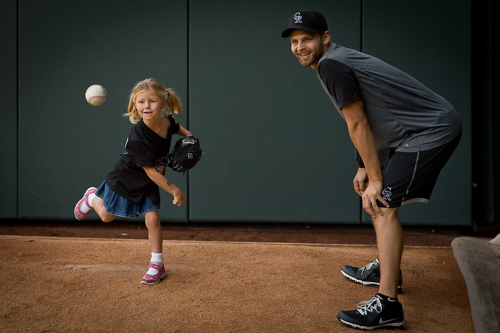 Colorado Rockies pitcher TAYLOR BUCHHOLZ watches a throw during the Back To The Basics Clinic held by the Colorado Rockies for their young fan club at Coors Field.