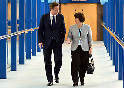 © Licensed to London News Pictures. 09/10/2012. Birmingham, UK The Prime Minister, David Cameron talks to Jane Ellison MP for Battersea on his way to the conference hall at the ICC today 9th October 2012. Photo credit : Stephen Simpson/LNP