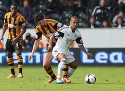 Hull's George Boyd battles with Swansea's Wayne Routledge - Photo mandatory by-line: Matt Bunn/JMP - Tel: Mobile: 07966 386802 05/04/2014 - SPORT - FOOTBALL - KC Stadium - Hull - Hull City v Swansea City- Barclays Premiership