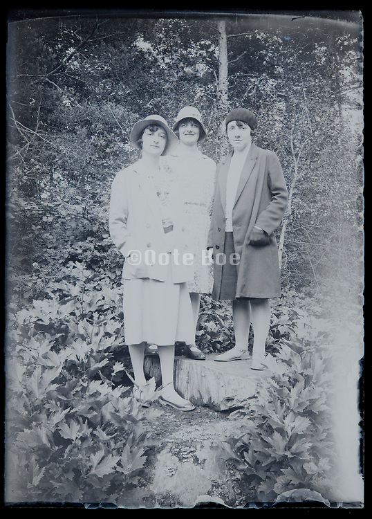 three adult women posing in nature setting fading negative France circa 1920s