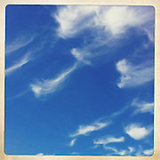 Cirrus clouds, mare's tails, against blue sky