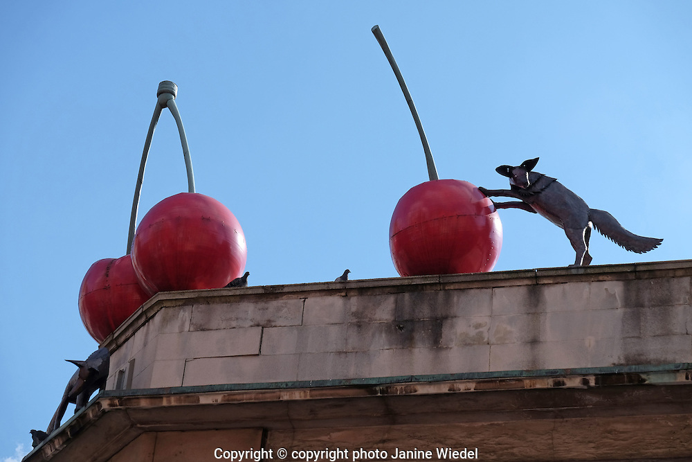"""Urban outdoor sculpture """"Foxes and Cherries"""" by Lucy Casson on rooftop in Brixton South London"""