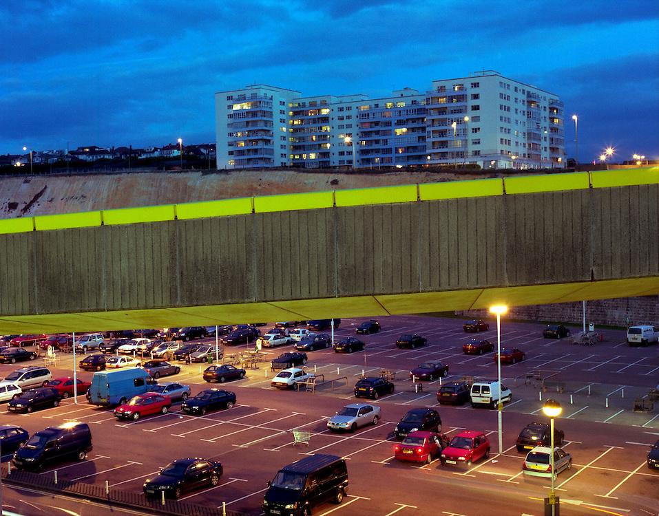 A car park, bridge and buildings at Brighton Marina.