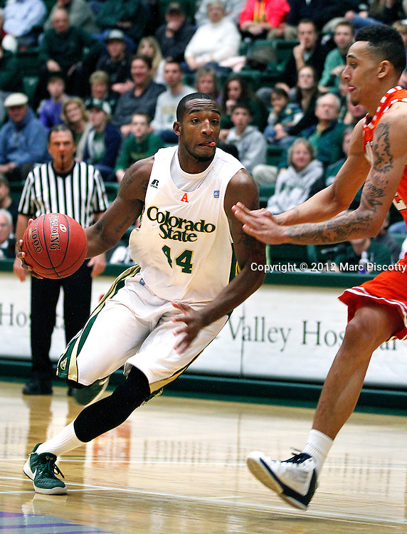 SHOT 1/2/13 9:19:32 PM - Colorado State's Greg Smith #44 tries to drive past UTEP's John Bohannon #21 during their regular season basketball game at Moby Arena in Fort Collins, Co. Colorado State won the game 62-58. (Photo by Marc Piscotty / © 2012)