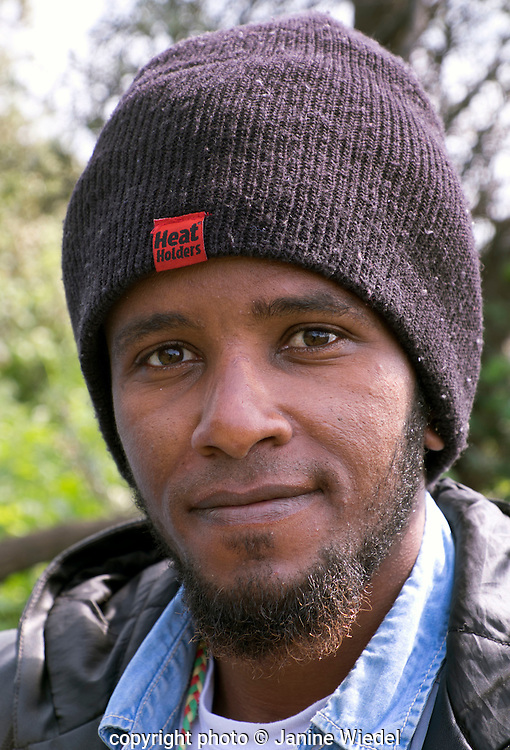 Portrait of Ethiopian Refugee in The Calais Jungle Refugee and Migrant Camp in France