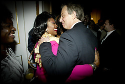 The British Prime Minister Tony Blair Meets Members of the Africian Community at Downing Street today Monday 11th October 2004.Tony Blair meets Bettie Pattiboulaye a singer from London   PA Photo Andrew PArsons .ROTA