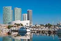 View of the Marina in Miami Bayside with modern buildings and skyline in the background.